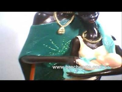 Africana familia, pintura em gesso, o feitiço da brancura