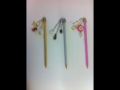 Lápis customizado com pingentes