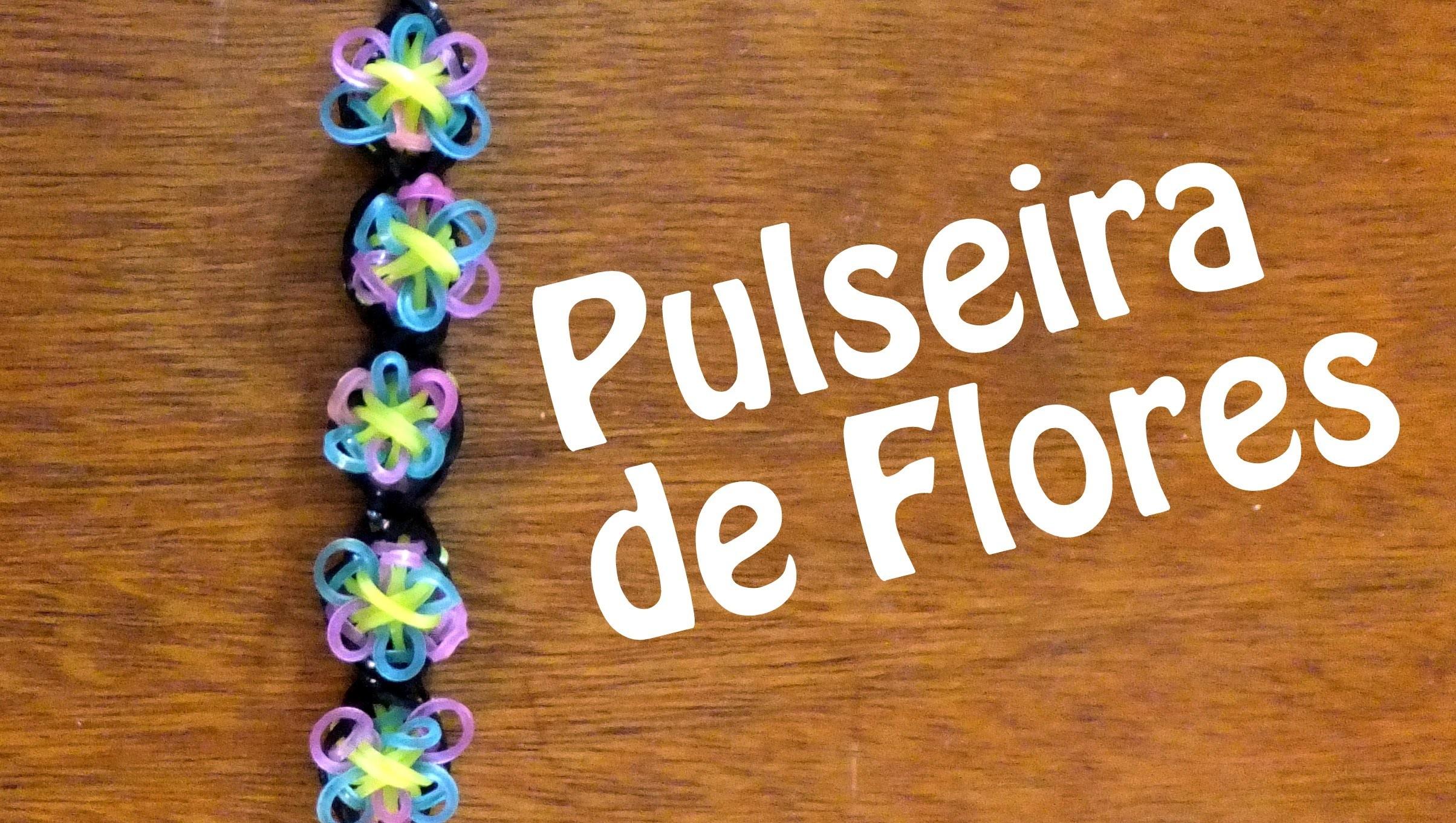 Como fazer uma pulseira de flores de elasticos rainbow loom