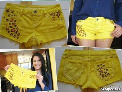Short amarelo com detalhe de oncinha by Customização & Cia