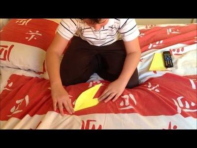 Origami de passáro que bate as assas