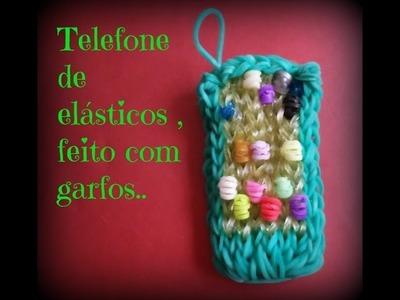 Telefone  de elásticos feito com garfos.