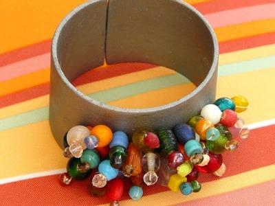 Upcycled Beaded Cuff Bracelet out of PVC. Encanamento Reciclado em uma Pulseira.