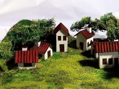 Maquete montanha e vilarejo. Maquette mountain and small villag. Modelo montaña y el pueblo