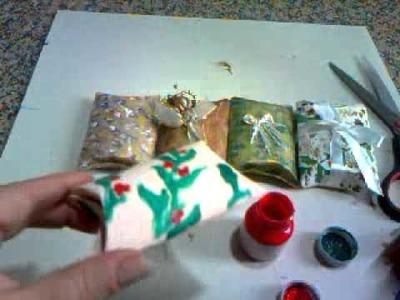 Caixinha de presente feito com rolinho de papel higiênico.