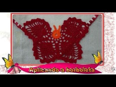 Costurando  a borboleta no pano de prato
