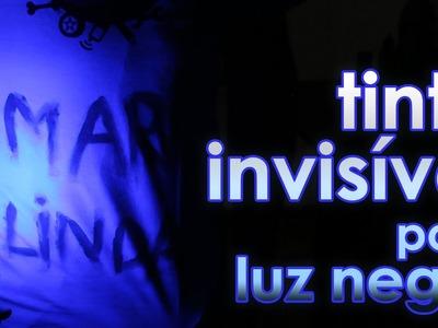 Tinta invisível para luz negra (experiência)