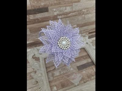 Arco feito com flor em guipir